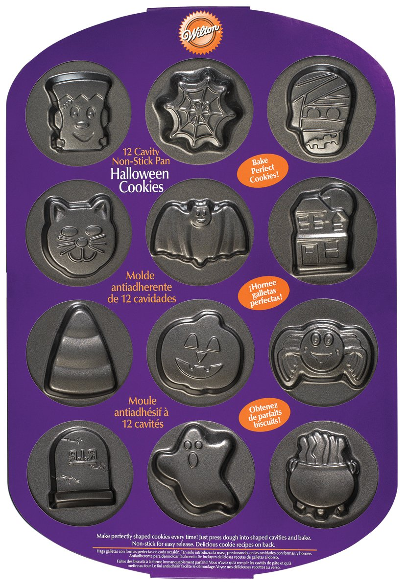 amazoncom wilton 12 cavity halloween cookie pan discontinued by manufacturer novelty cake pans kitchen dining - Halloween Cookies Decorating Ideas