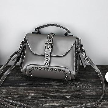 e079f4e24def Amazon.com  LtrottedJ Retro Women s Rivets Leather Shoulder Bags ...