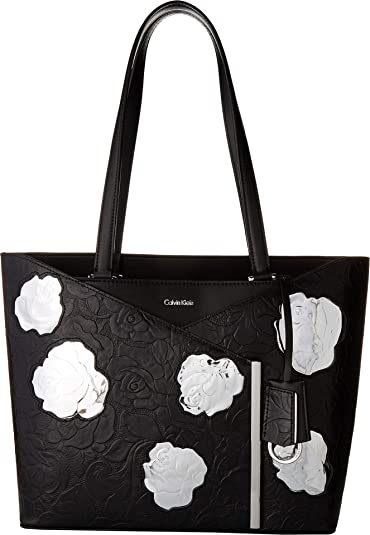 31bc58b8377 Amazon.com: Calvin Klein Women's Mara Metallic Tooled Roses Tote Metallic  Rose One Size: Shoes