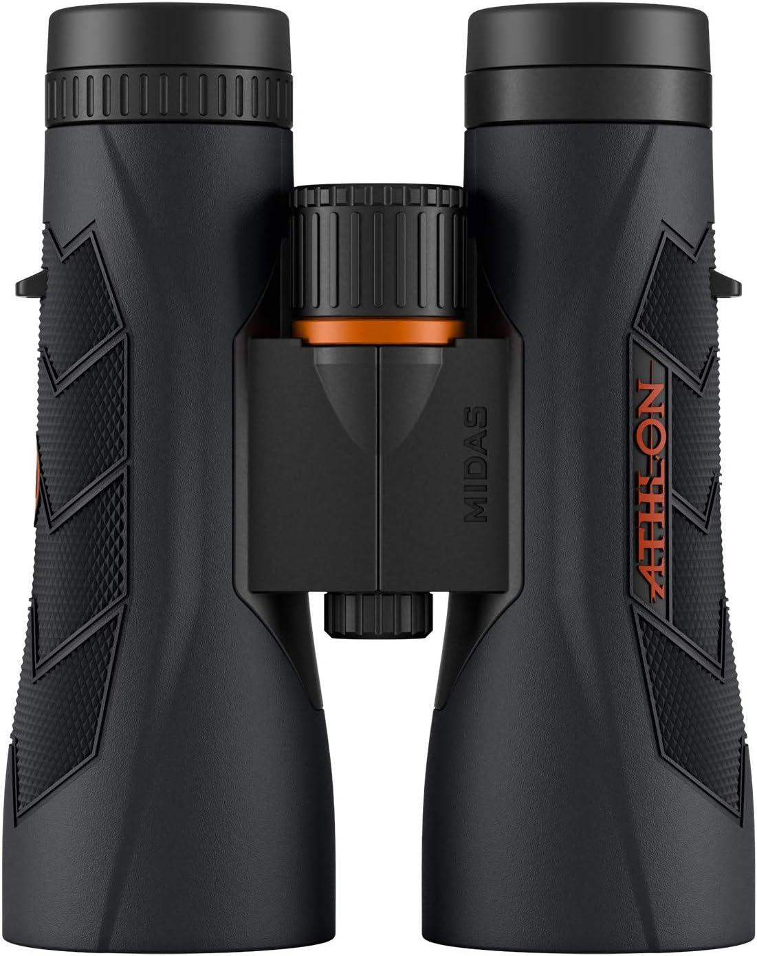Image of a binocular pair in black with orange details on it. Lens facing downwards