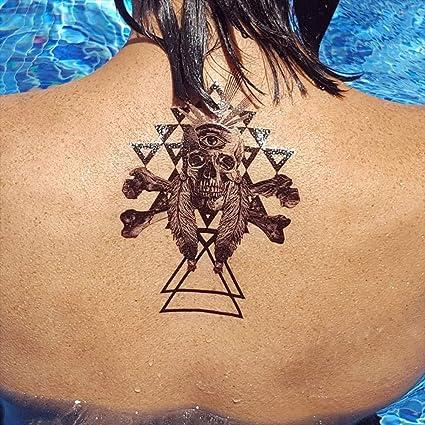 Tatuajes temporales de cráneo con ojo y triángulos geométricos ...