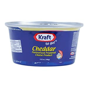 Kraft Prepared Pasturized Cheddar Cheese, Pantry Staple Cheese Spread for Crackers, No Refrigeration Needed Before Opening 3.5 oz