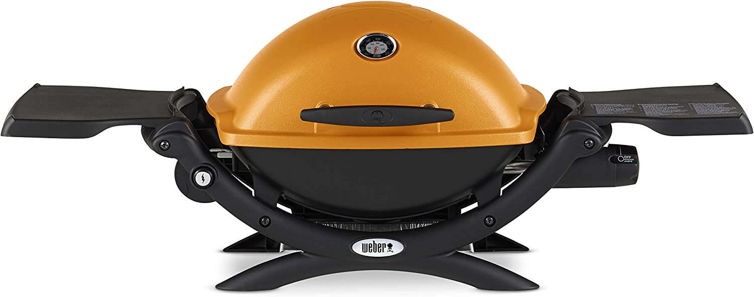 Image of a portable grill with side space, lid closed with a built-in thermometer, yellow color lid.