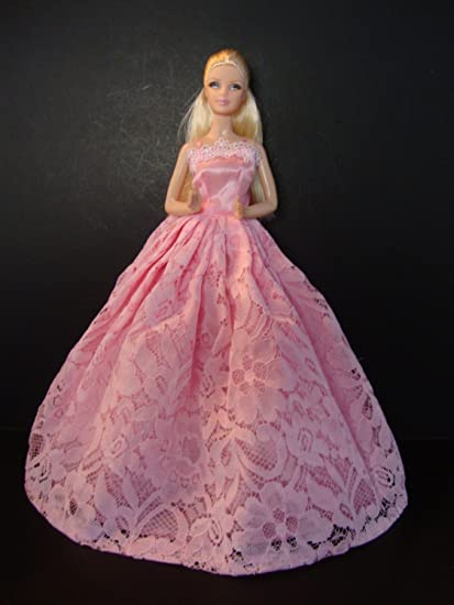 cab77ccada3 Amazon.com  Lovely Yet Simple Pink Gown with Pink Flowered Lace on ...