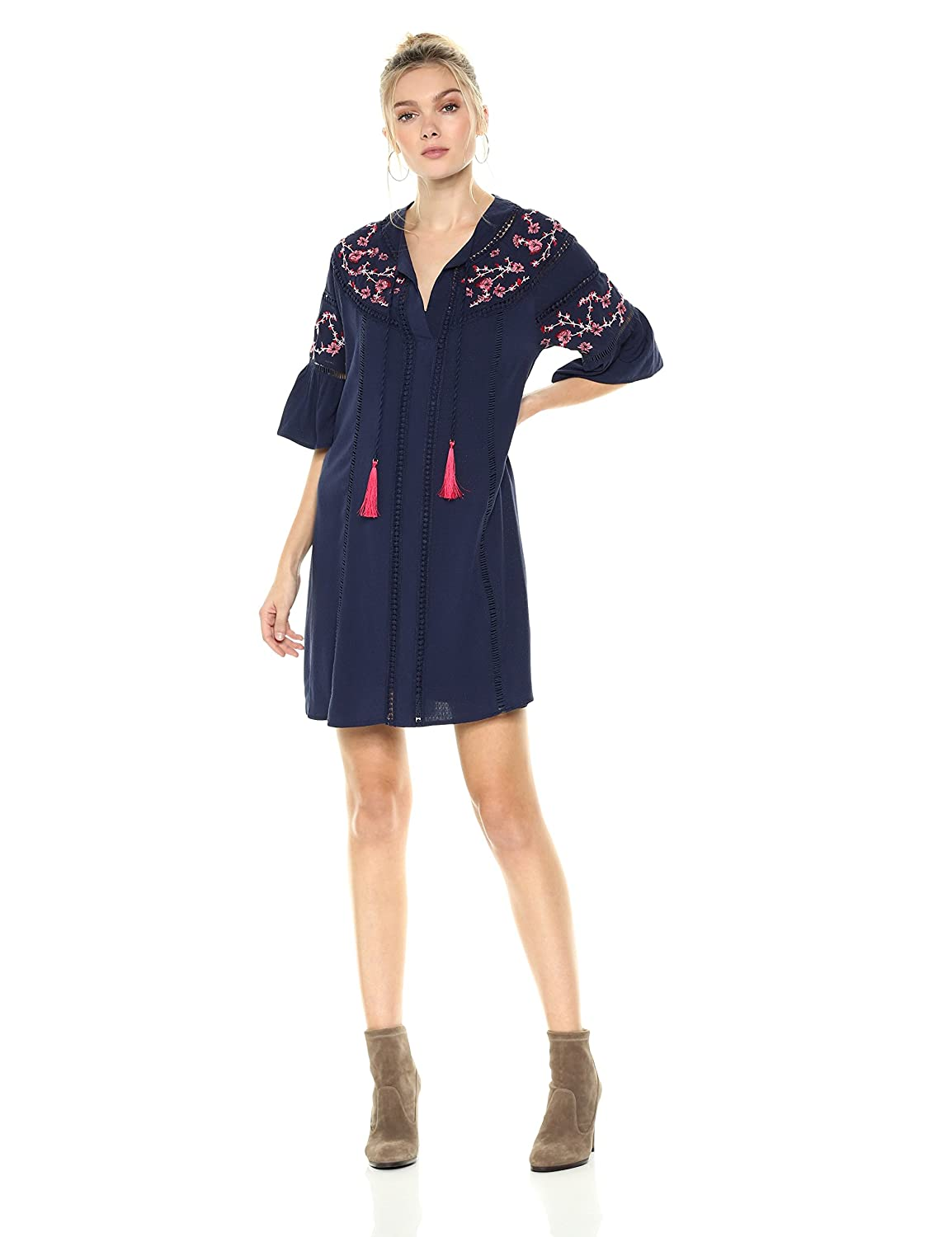 5f2ce514ad A bell-sleeve peasant dress made of shimmery fabric features tassel-trimmed  neck ties, intricate floral embroidery, and crochet dot trim for a look  that\'s ...