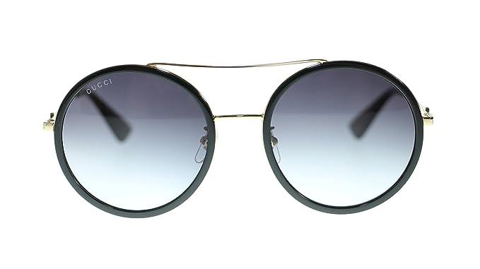 28e439e7d1 Gucci Women Round Sunglasses GG0061S 001 Gold Black Grey Gradient Lens 56mm  Authentic  Amazon.co.uk  Clothing