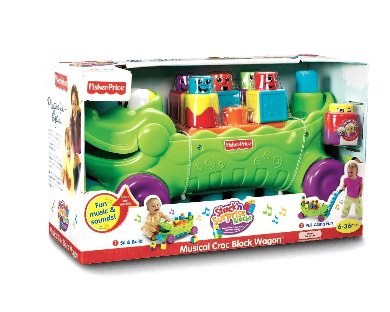 37024066f Amazon.com  Fisher-Price Stack  n Surprise Blocks Musical Croc Block Wagon   Toys   Games