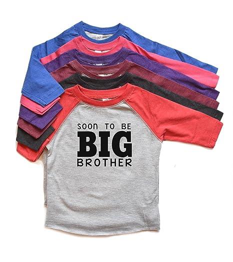 f365e202b45 Amazon.com  Soon To Be Big Brother Raglan Shirt Toddler Boy Tee New Baby  Annoucemnet tshirt New Sibling Heads Up Shirts  Clothing
