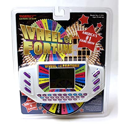 Tiger Electronics Wheel of Fortune Handheld: Toys & Games