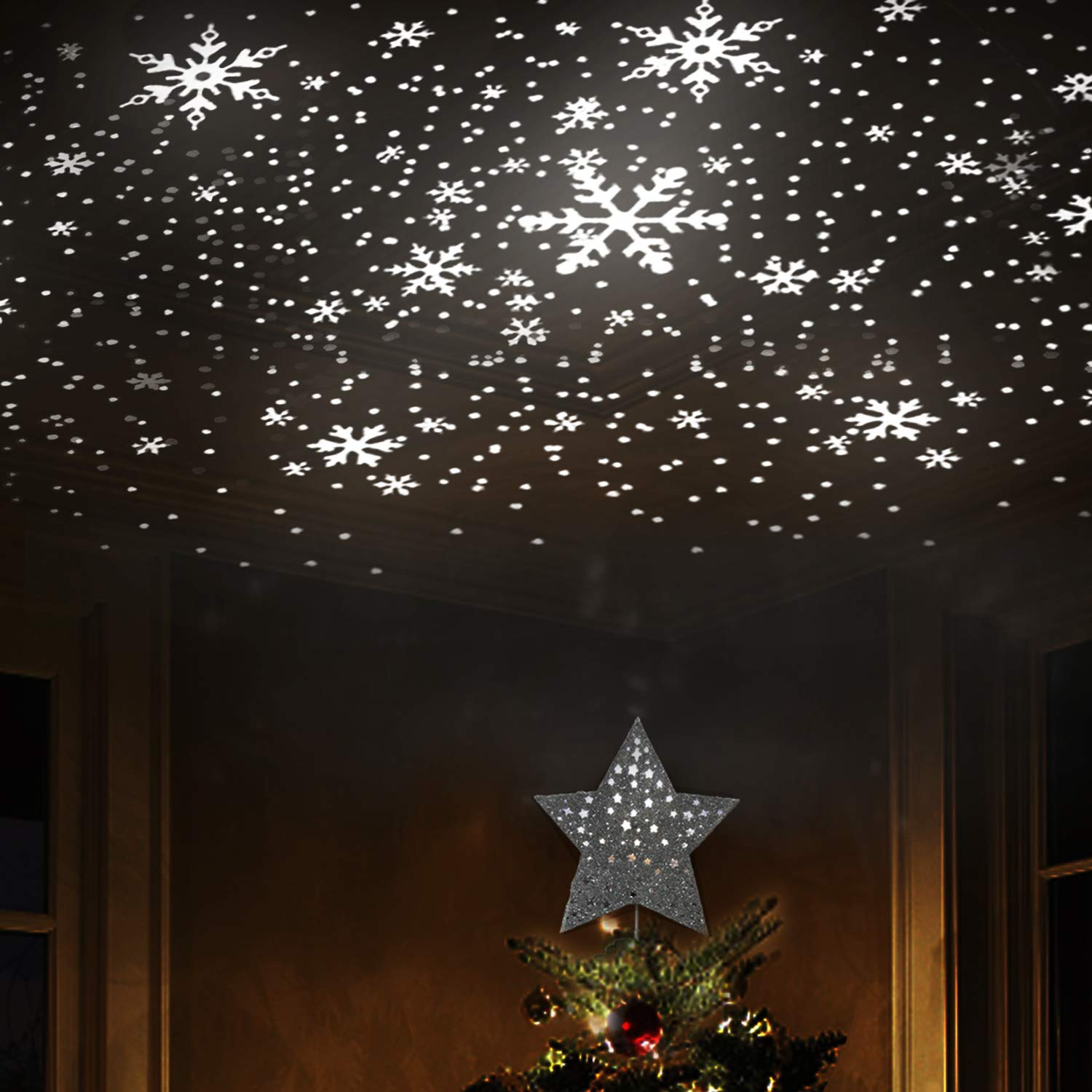 Amazon com eambrite 9 hollow silver star christmas tree topper with rotating magic cool white snowflake projector for xmas tree decoration home kitchen