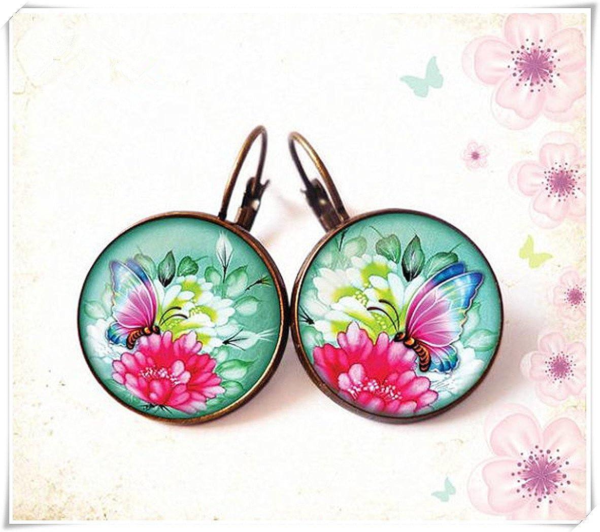 Elf House Pendientes de tuerca de cabujón con diseño de mariposa sobre flores, color rosa turquesa y cúpula de cristal, hechos a mano