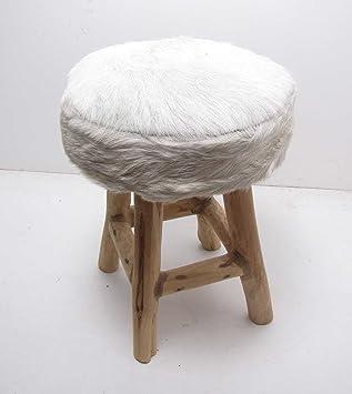 : Uriger Hocker aus Holz mit Ziegenfell Bezug