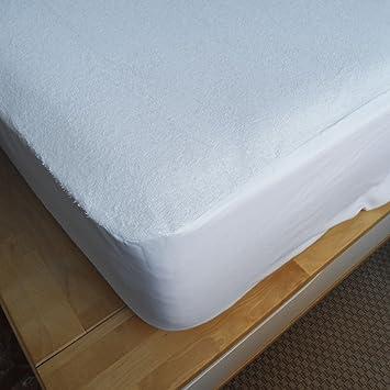 Sabanas Blancas Protector de colchón transpirable e impermeable. Medidas de colchón 160x200x25: Amazon.es: Hogar