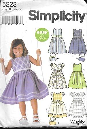 b4cdafbc5 Patrón de costura Simplicidad 5223 - tamaño BB 5,6,7,8 - Vestido de niña  con con variaciones y bolso de mano: Amazon.es: Juguetes y juegos