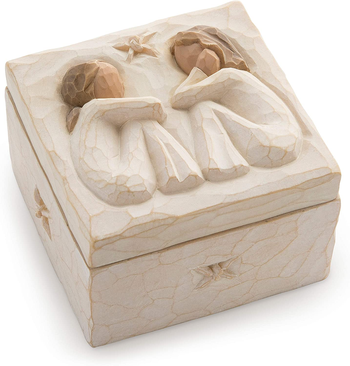 This is an image of a box with sculpted figures on top of it.