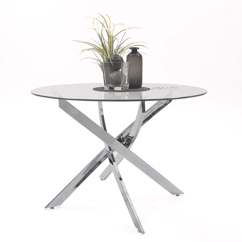 Original mesa de comedor modelo Dalila con patas en acero pulido y originales formas.