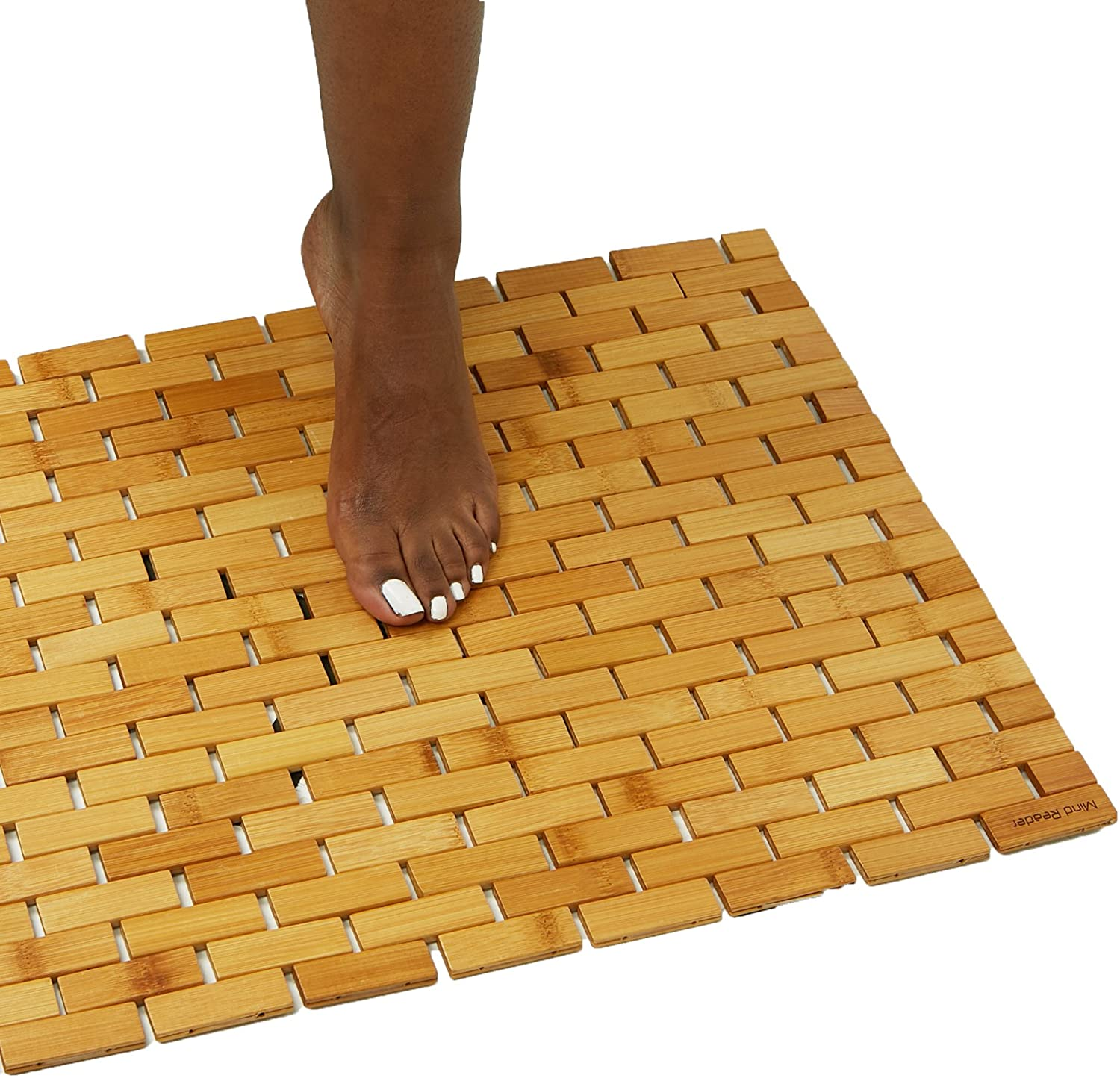 Woman stepping onto a bamboo shower mat