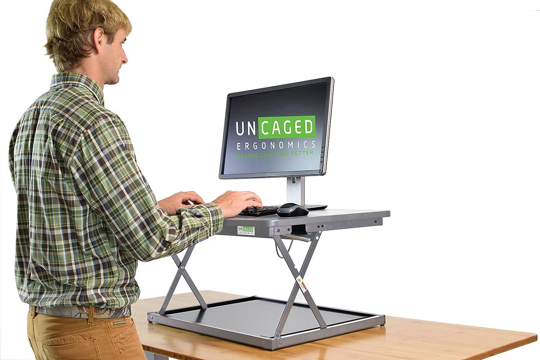 CHANGEdesk Mini Affordable Adjustable Height Laptop/Desktop Standing Desk Conversion. Compact ergonomic sit to stand desktop computer riser converter Uncaged Ergonomics CDMM-b