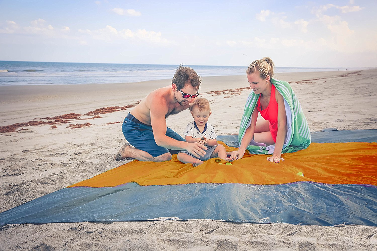 Travel EZ Huge Family Beach Blanket Picnic Blanket by 9 Feet X 7 Feet – 4 Anchor Loops and Stakes 4 Sand Anchors – Parachute Nylon – Zipper Pocket for Valuables