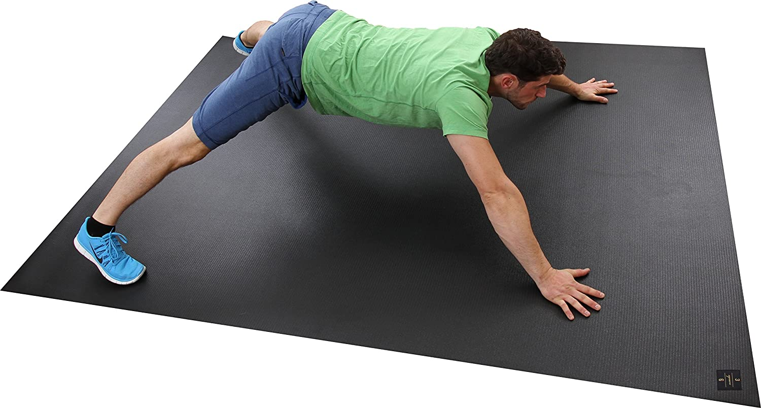man in green shirt stretching on exercise mat