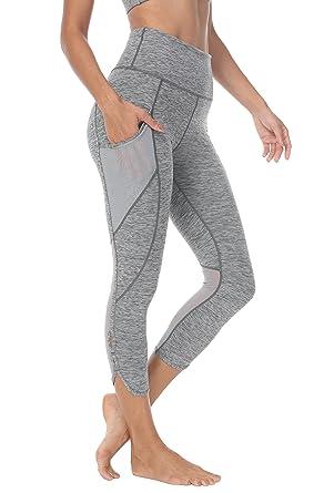 "f5c9ab37fc QUEENIEKE Women 22"" Yoga Capris Power Flex Medium Waist 3 Phone Pocket  Running Pants Trousers"
