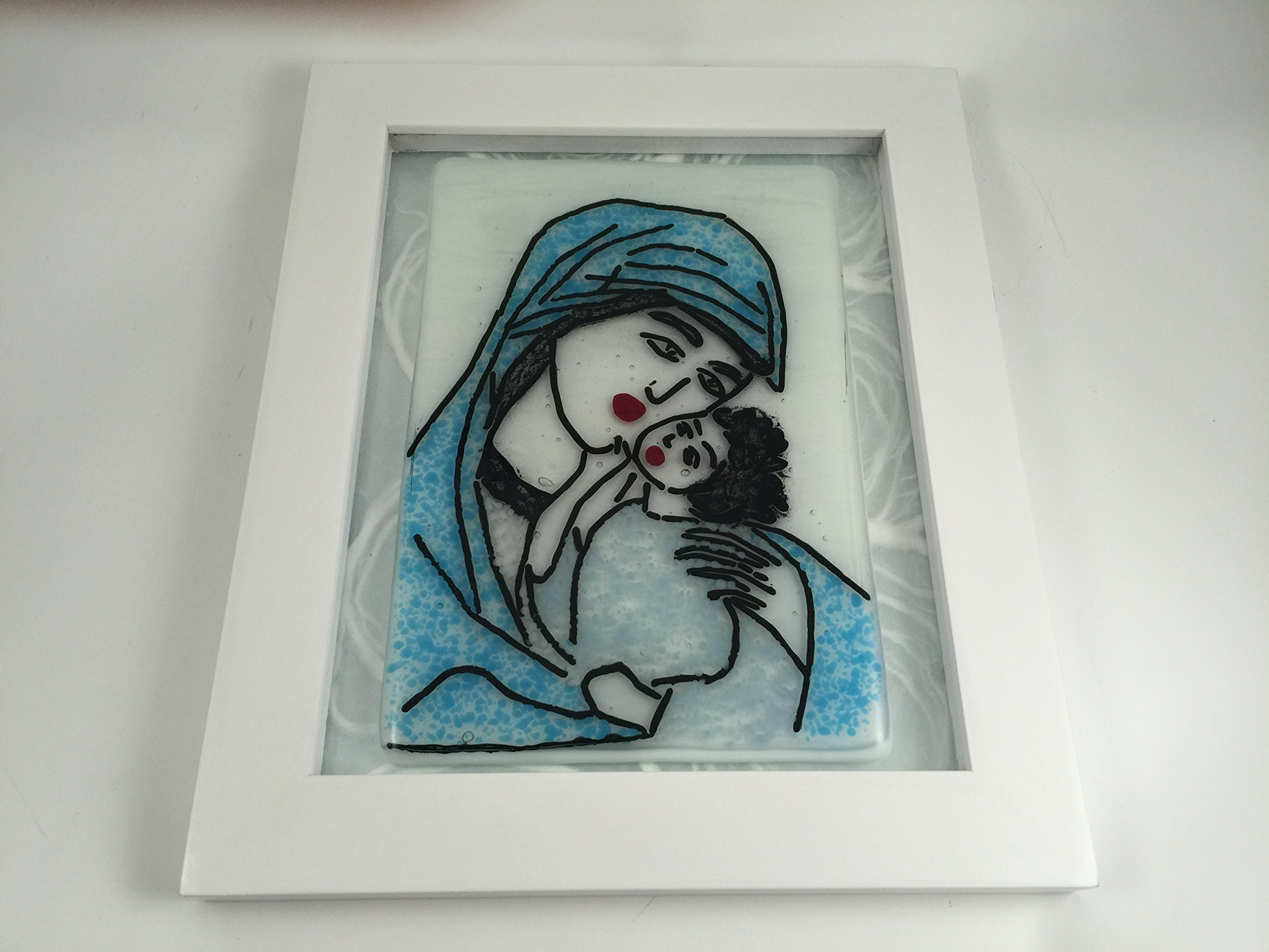 Mother & child in black stringer with blue chips on pearl white inch fused glass panel