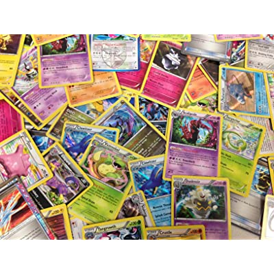 50 Assorted Pokemon Cards with Bonus Holo Foils: Toys & Games