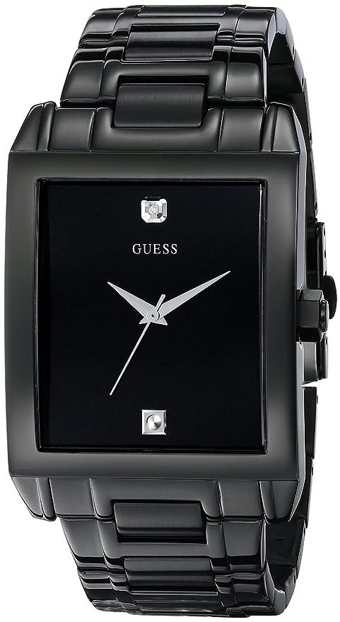 8e0a1ff94dbb Elegante reloj GUESS en acero inoxidable laqueado en negro. De caja  rectangular y minimalista
