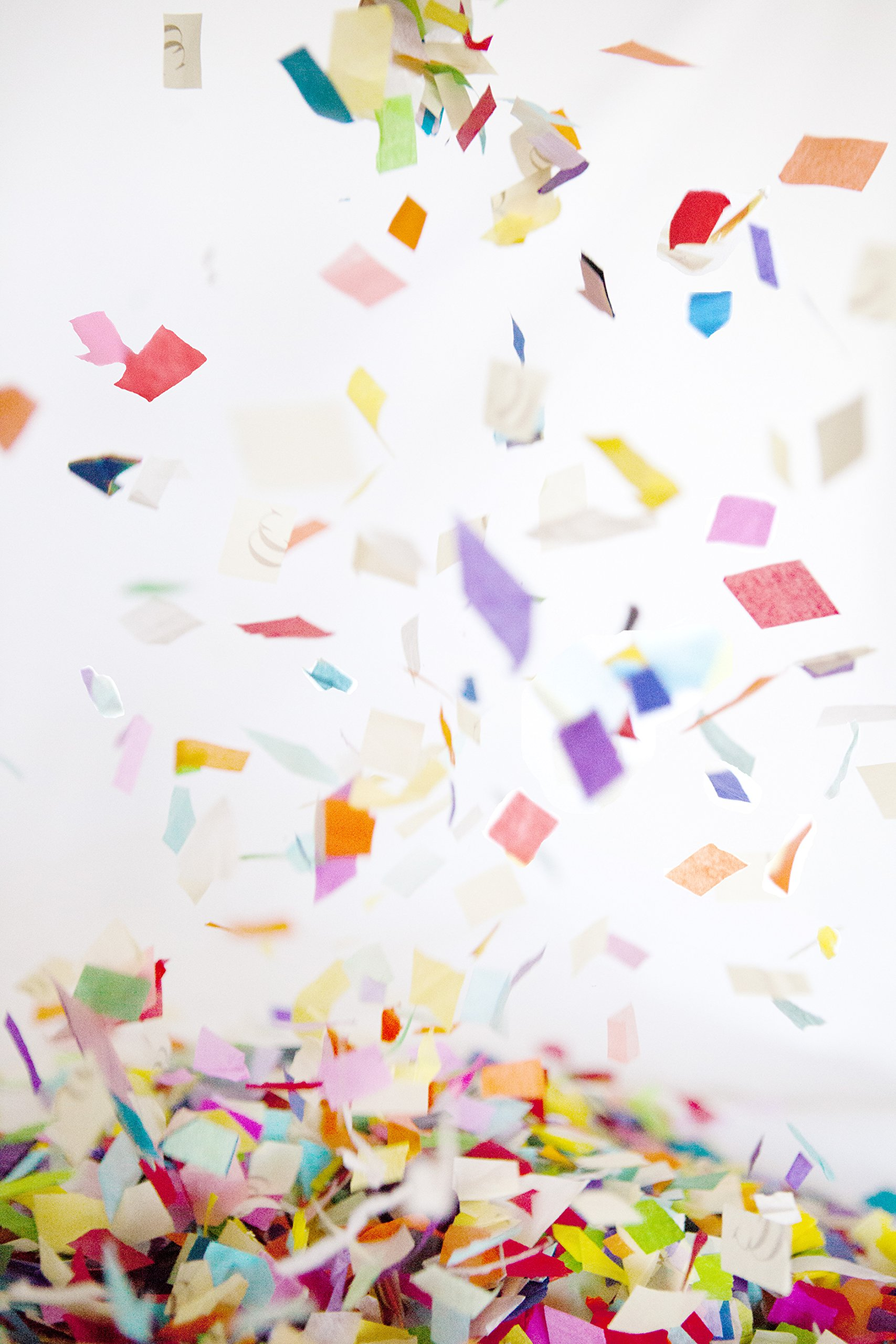 Colorful Rainbow Shredded Tissue Paper Confetti, bulk jumbo bag. Made from recycled paper. For birthdays, engagements, and surprise parties.