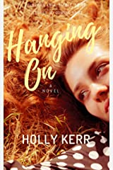 Hanging On: Humorous and Heartwarming Sister Saga (Sisters in a Small Town Book 2) Kindle Edition