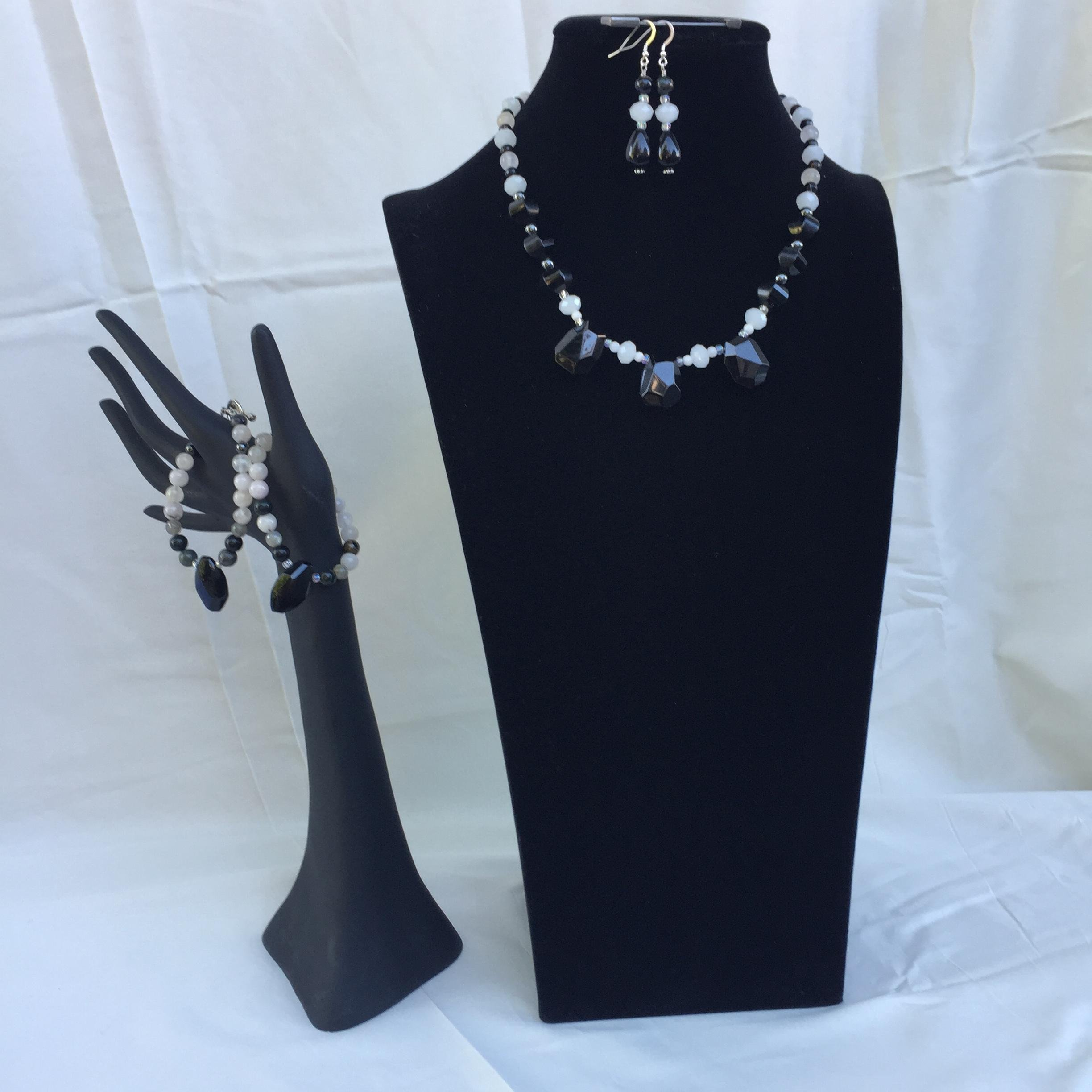 Stunning handmade jewelry set with a necklace, two bracelets and matching dangle earrings. Black and white mixed gemstones. One of a kind