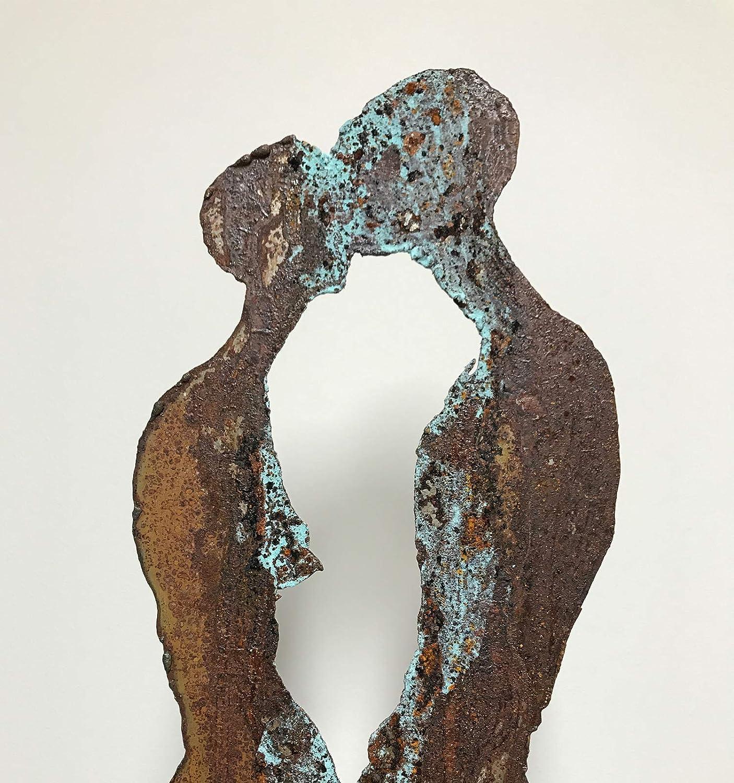 MC - Escultura de Hierro Oxidado, diseño de El Beso