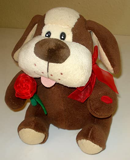 Amazon Com Puppy Soft Plush Holding A Rose Sings And Moves To I M Just A Love Machine Sits 10 Inches Toys Games