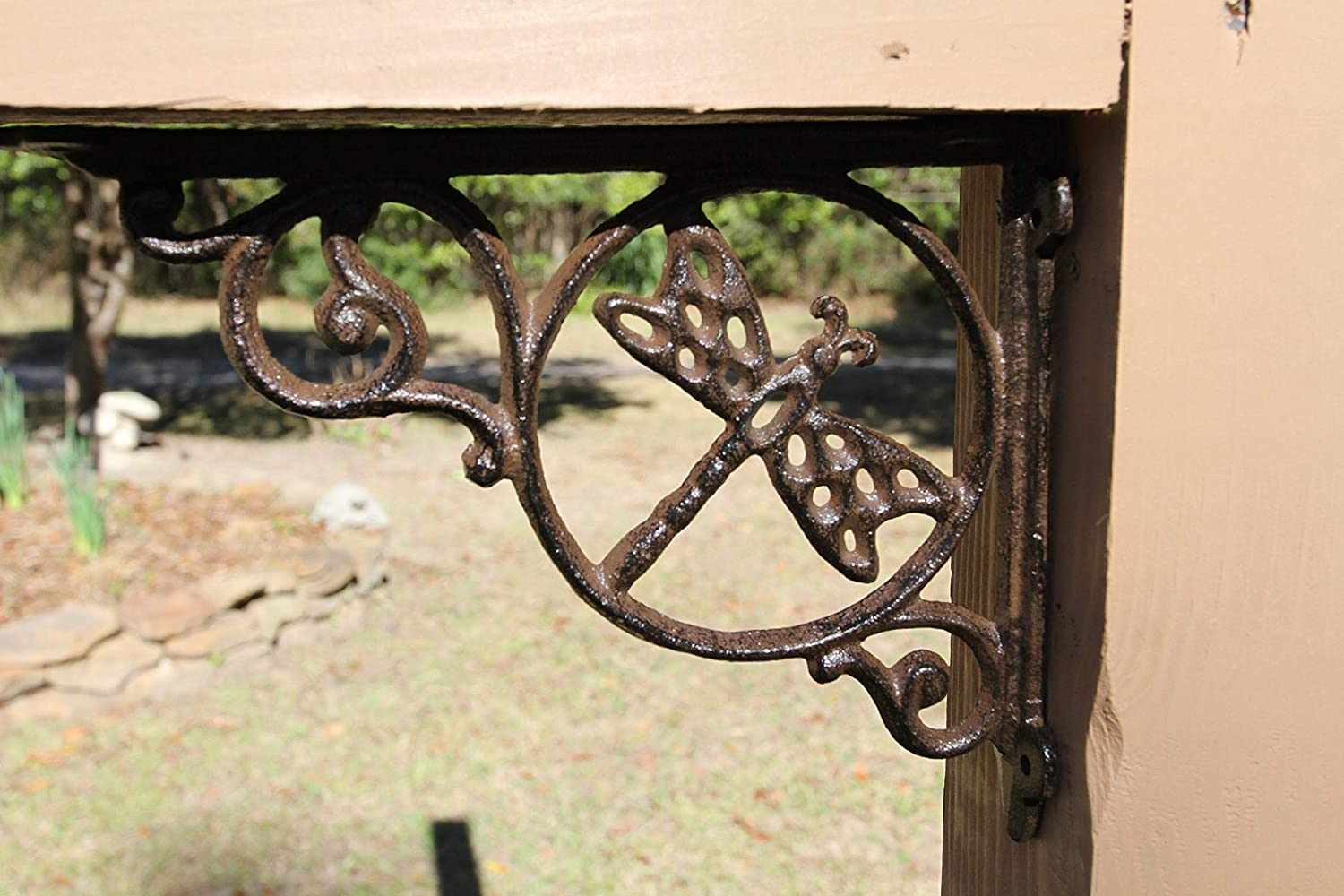 4 Cast Iron Shelf Brackets with a Large Dragon Fly in a circle.