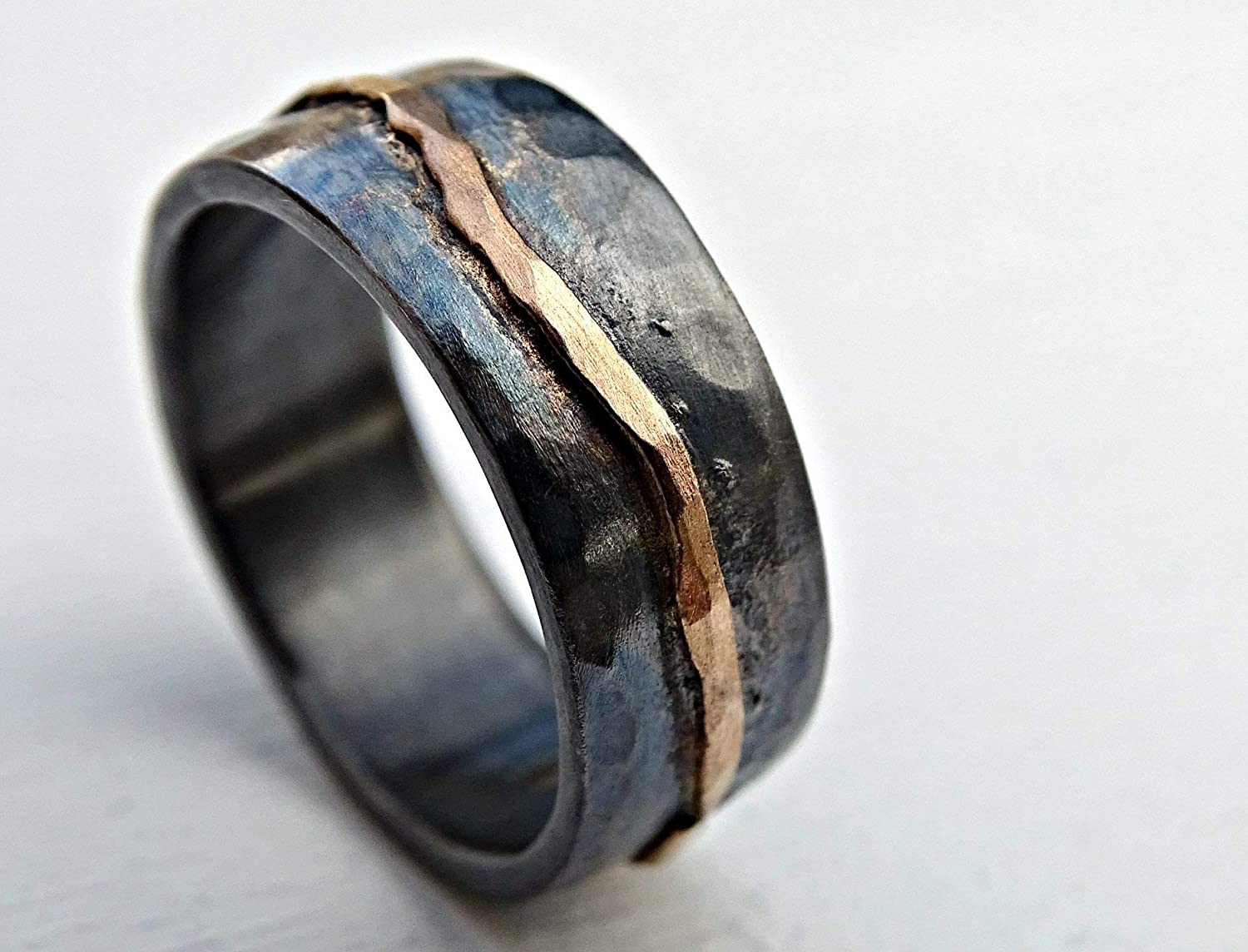 It is a photo of hammered gold wedding band black silver, man wedding band, organic wave ring gold, viking wedding ring forged, celtic promise band, cool mens ring