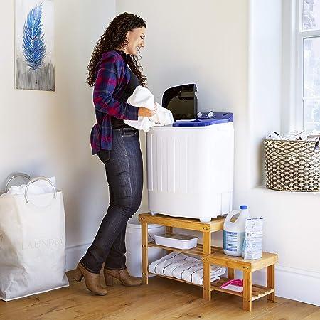 Women-Putting-Hand-In-Washing-Machine