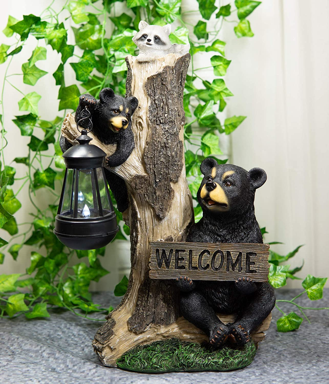 Ebros Gift Rustic Forest Black Bear Mother Sitting Near Cub and Raccoon Family by Weathered Tree Welcome Sign Statue with Solar LED Light Lantern Home Patio Path Lighter Bears Guest Greeter Figurine