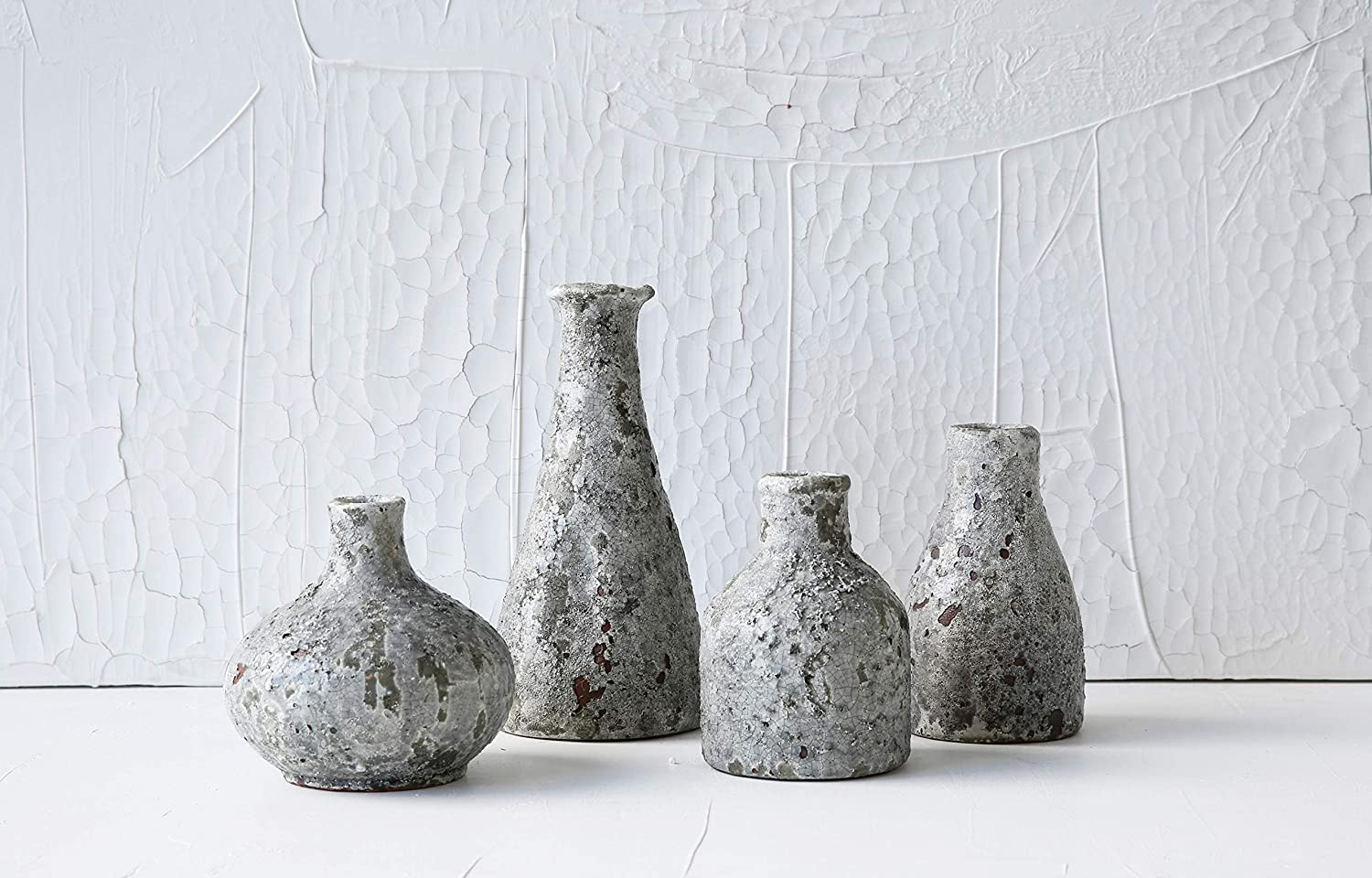 Rustic and distressed, these grey vases impart French farmhouse style and European country charm.