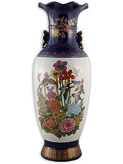 Giant Gl Vase on giant teapot, giant bowl, giant garbage can,