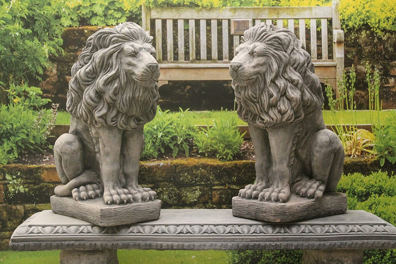 Pair of stone lions statues garden ornaments Amazoncouk Garden