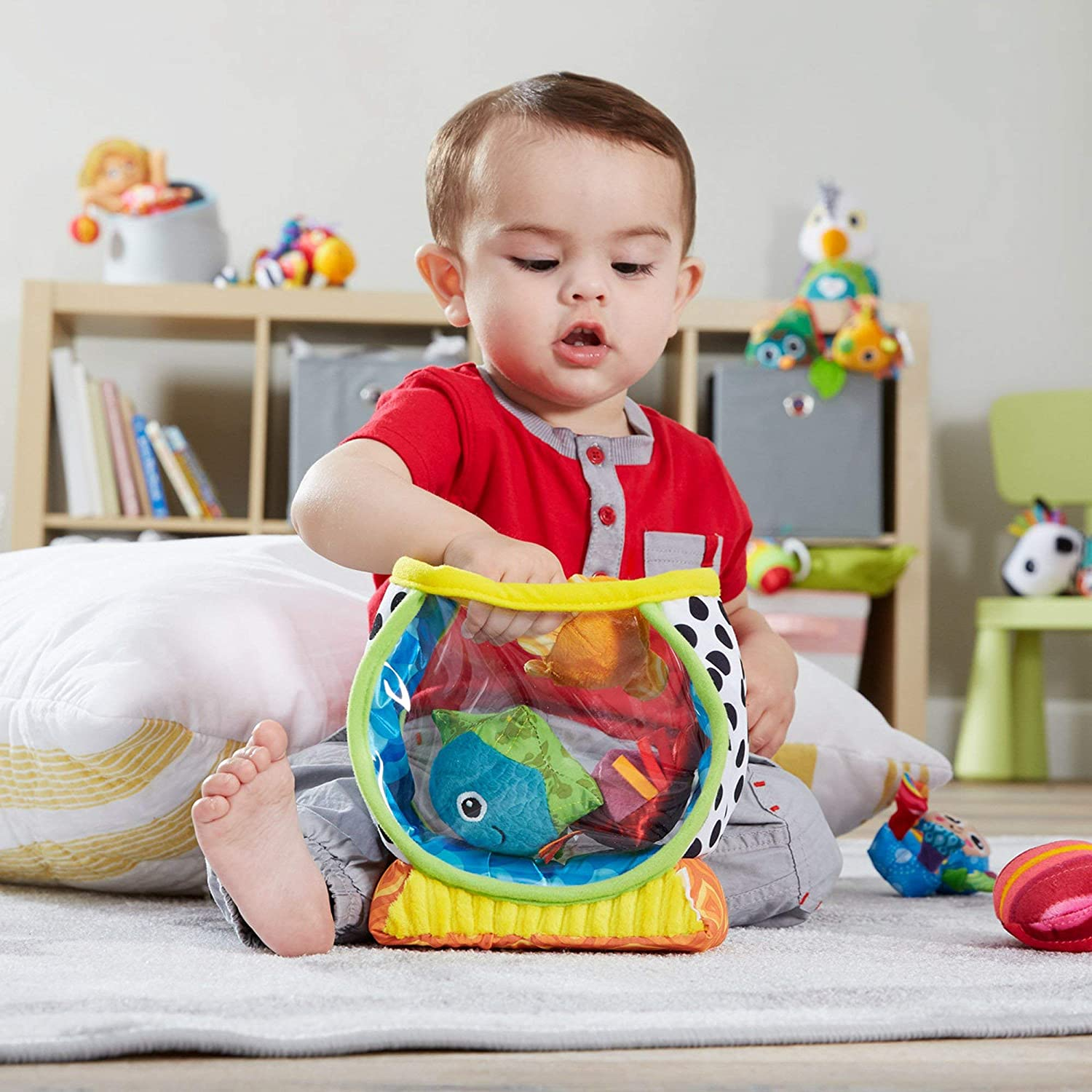 Capture Babys Curiosity with Sea Creatures to Rattle Squeak and Collect with Colorful Patterns Interesting Textures and Unique Sounds My First Fishbowl Toy 6 Months and Older Capture Baby/'s Curiosity with Sea Creatures to Rattle L27204Z LAMAZE
