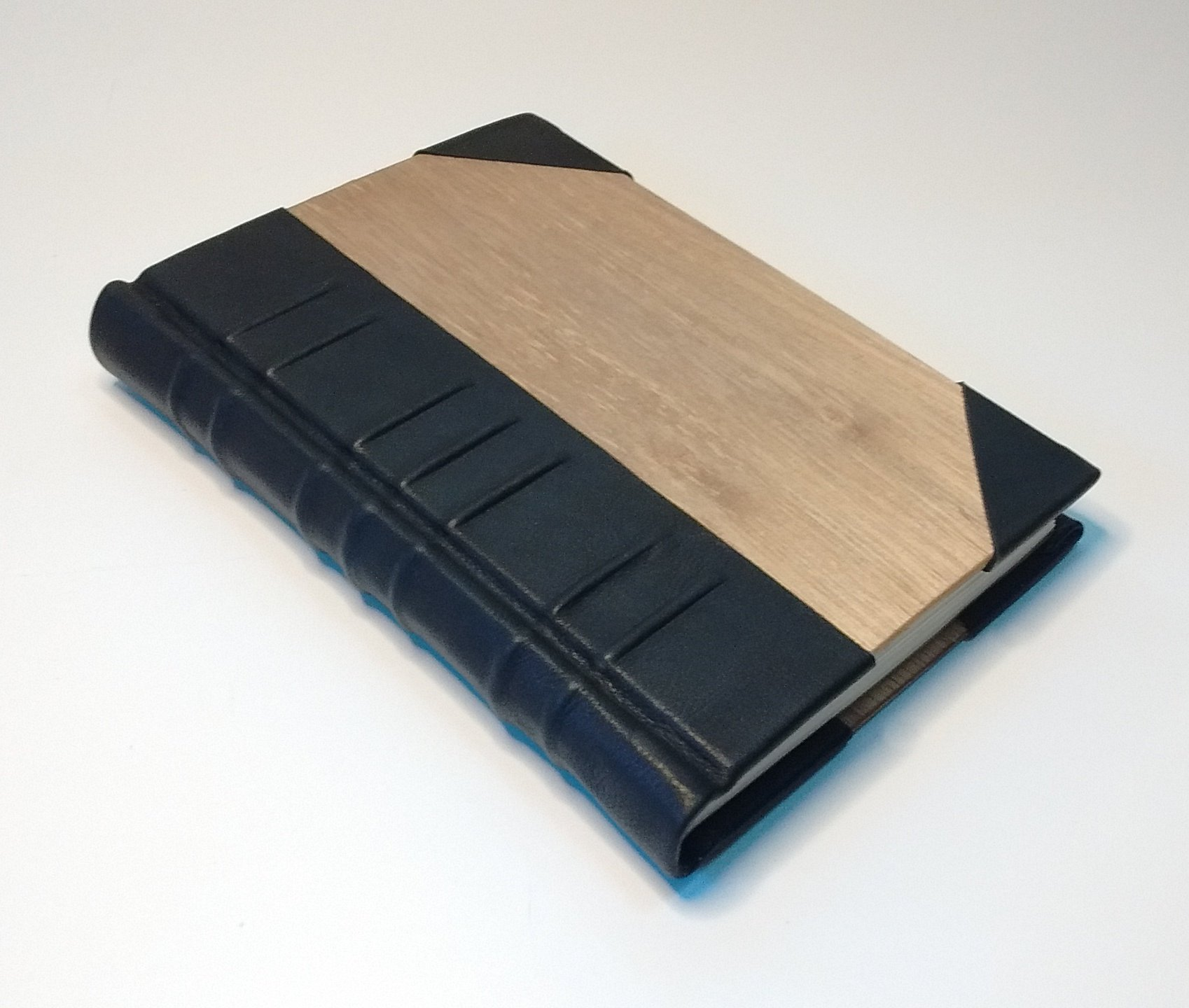 Elegant handmade book, case-bound, with raised bands, in wood and black leather. Journal, blank book, diary, sketchbook.
