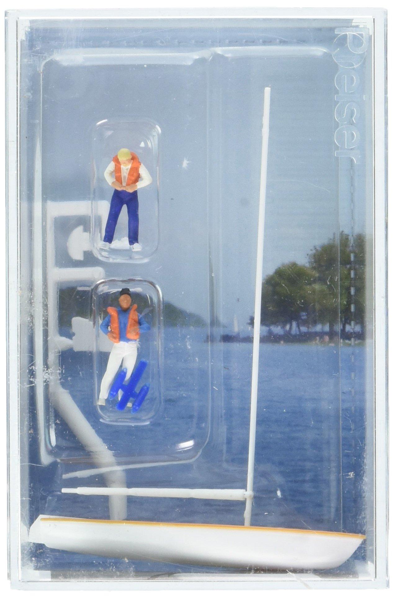 Preiser 10678 Korsar Sailboat w/2 Sailors Putting On Life Jackets Sails Down (White, Yellow) HO Scale Figure
