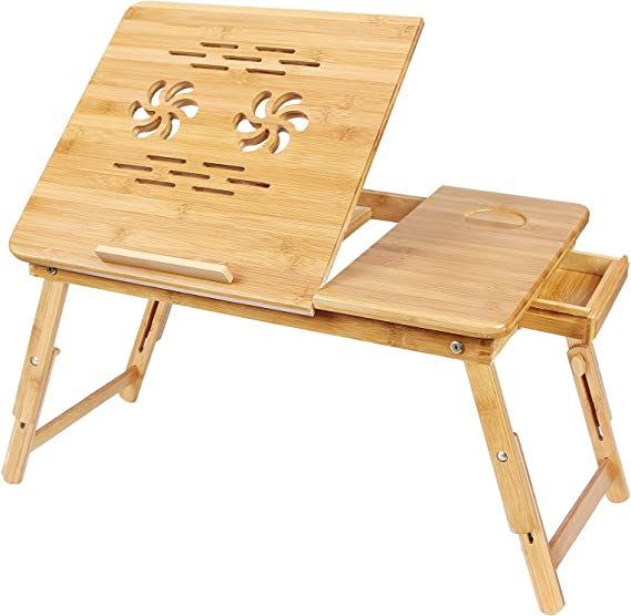 person using a bamboo desk to work on their computer