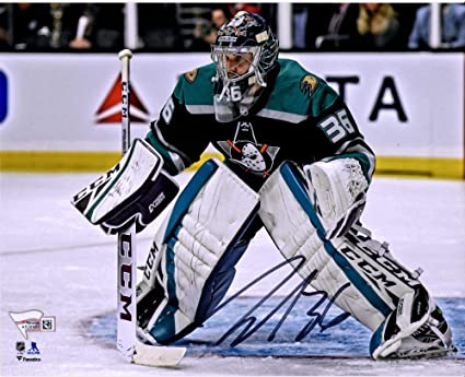 John Gibson Anaheim Ducks Autographed 8 x 10 Alternate Jersey in Net Photograph Fanatics Authentic Certified
