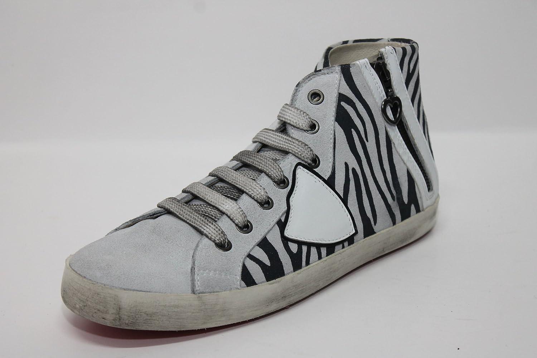 Sneaker zebrino bianco/nero e camoscio bianco 42