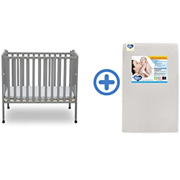 newest 524d0 a0c06 Delta Children Folding Portable Mini Baby Crib & Twinkle Stars 3-Inch  Waterproof Portable Crib...