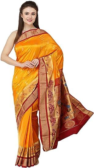 e5fdd9cf9d Exotic India Radiant-Yellow Uppada Sari with Paithani Pallu and Peacocks on  Border  Amazon.co.uk  Clothing