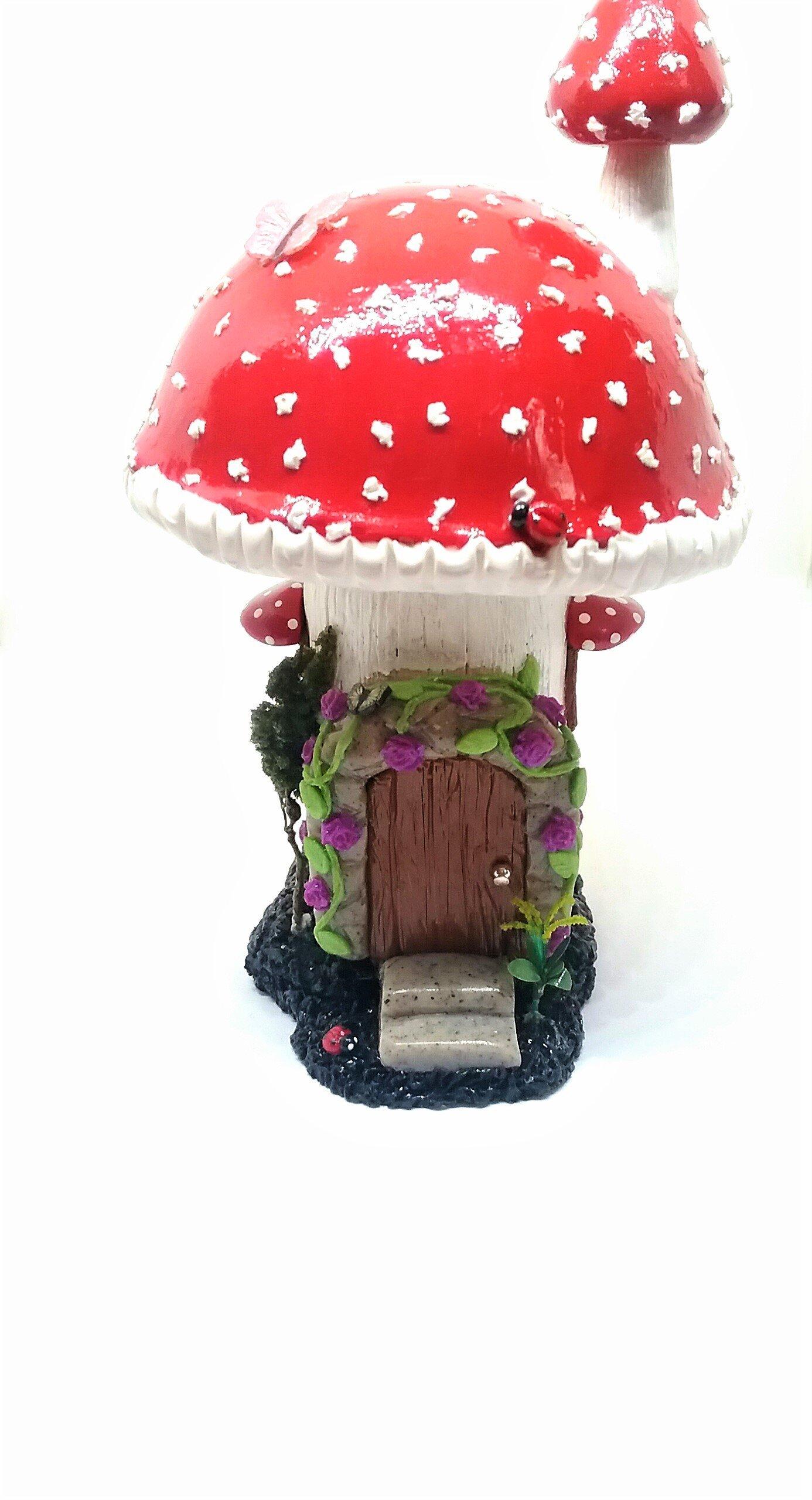 Miniature fairy red mushroom house with glow ion the dark windows. Fairy garden accessories.