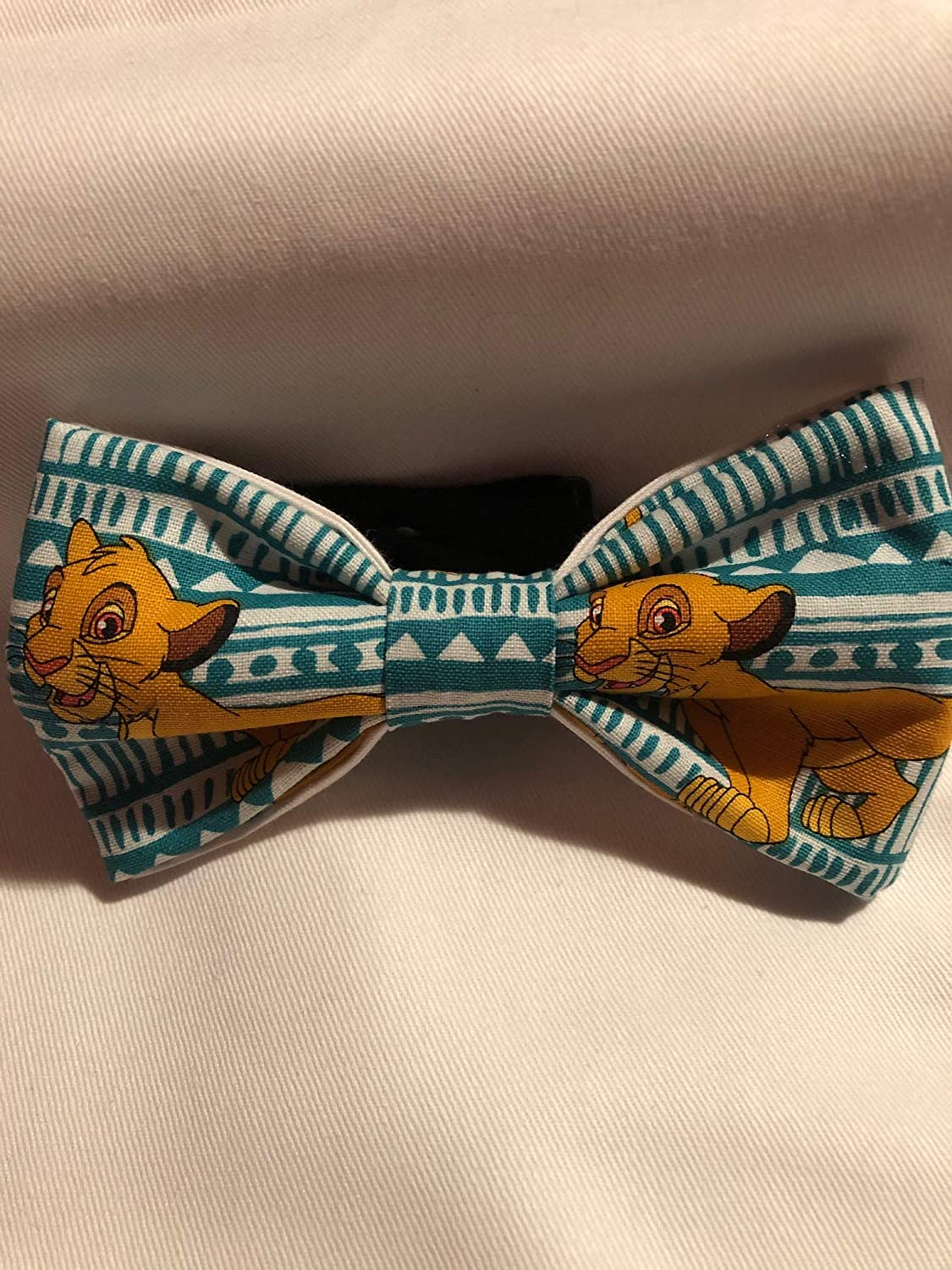 teen cotton pre-tied bow tie with black cotton twill strap. Lion King Young Simba youth toddler sized